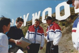 Joe Toplyn, Jay Leno, and Charlie Sheen discuss a stunt at the foot of the Hollywood Sign.