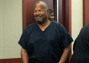 A grinning and overweight O. J. Simpson in court