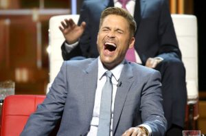 Rob Lowe laughing at a roast joke